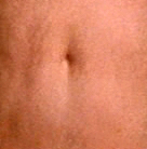 Whose belly button is this?