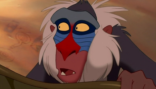 Simba hugs Rafiki after the fight with Scar.