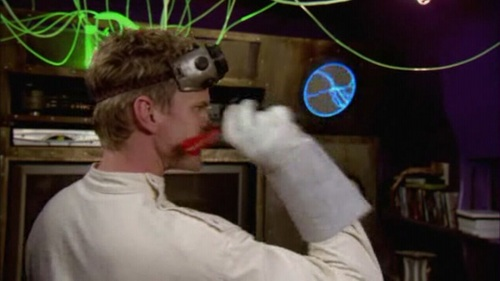 On what spaces do the darts land when Dr. Horrible throws them at the dartboard?