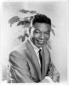 In what year did Nat King Cole's marriage to his first wife end?