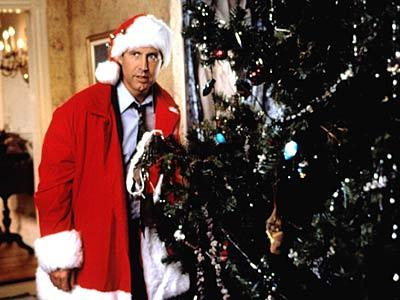 Chevy Chase is dressed as a santa in which film ?