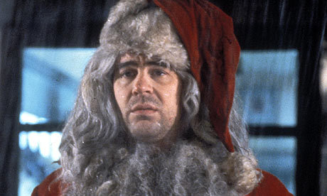 Dan Akroyd is dressed as a santa in which film ?