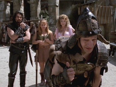 "In ""The Quill is Mighter"" when Gabrielle was describing Xena What was Ares first word of describing her?"
