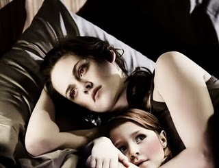 When Charlie was coming to see Bella for the first time at the Cullens' home, why did Bella insist on holding Renesmee?