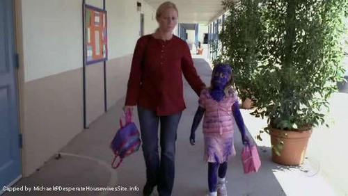 What is the name of the girl the Scavo twins painted blue in season 1?