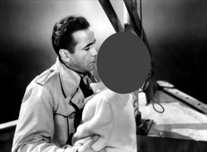 Who is in Bogart's arms ?