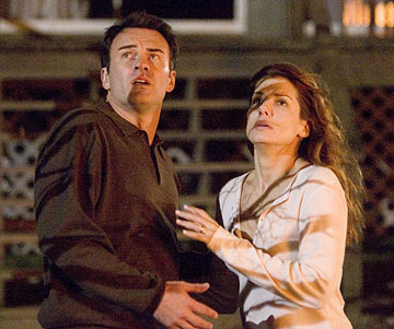 What is the name of the actor with Sandra Bullock in this picture?