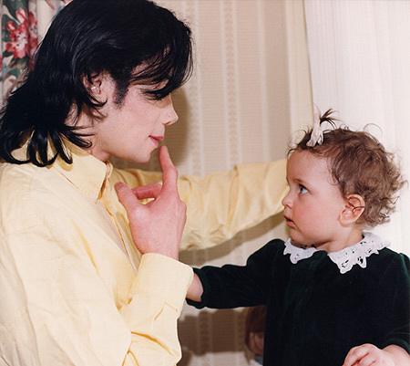 In this foto Michael is with one of his children...who?