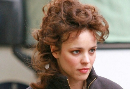 Irene Adler shows up on Baker straße to engage Holmes' services. What does she want him to do?