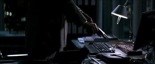 Lau is pulling out a weapon from his desk when Batman cuts the power. What gun is it?
