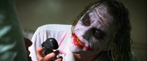 Joker gives Harvey Dent this gun: