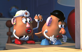 In the beginning of Toy Story 2, what book is Mrs. Potato Head reading?
