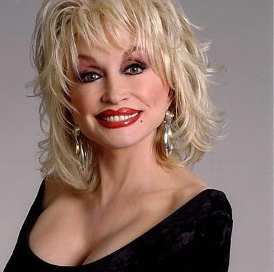 In what साल did Dolly win a Grammy Award for Best Female Country Vocal Performance for her Here आप Come Again album ?