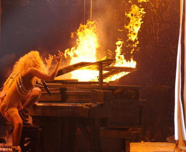 from which singer do gaga got the idea with the burning piano?
