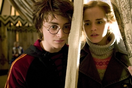 Did hermione kiss harry on the head in the Goblet of Fire (movie)