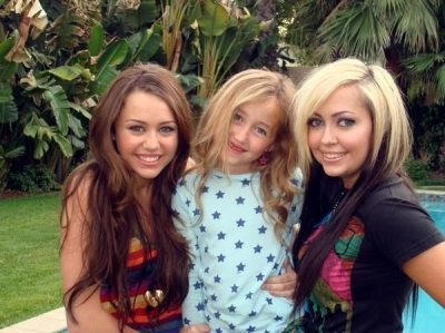 who are the two girls in pic with miley