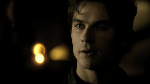 Damon is looking at Bonnie.