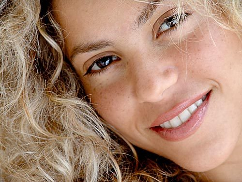 shakira was ---- when she wrote her first song?