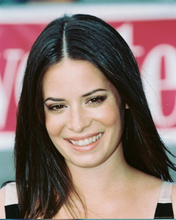 which actress from charmed(tv series) who plays aria's mother,ella on pll ??