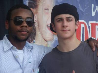 Who is in the picture with David Henrie?