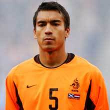 How many interlands will Giovanni van Bronckhorst have played by the end of the FIFA World Cup 2010?