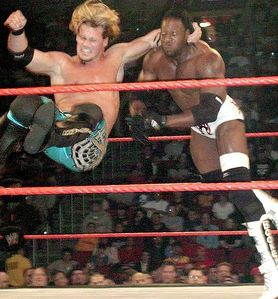 What is the name of the 옮기기 that Chris Jericho is performing on Booker T?