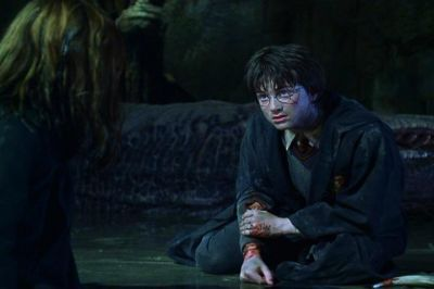 'Oh get out of the way, Percy. Harry's in a hurry.''Yeah, he's off to the Chamber of Secrets for a cup of tea with his fanged servant.' Who 2 people said this?(book COS)