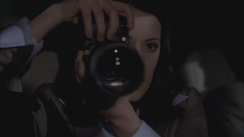 In 2x19 Ashes and Dust Prentiss is taking pics of: