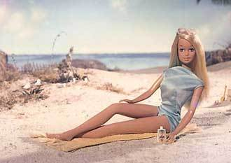 A standard Barbie is ______ inches Tall .