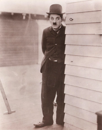 What was the name of the very first film Chaplin appeared in?