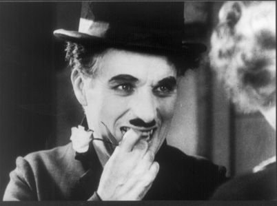 In January, 1931, which famous scientist took a break from his busy work to attend the first showing of 'City Lights' alongside Charlie Chaplin?