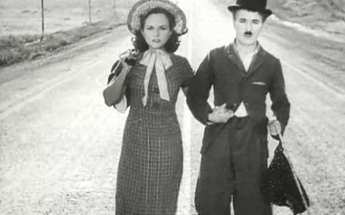 In 'Modern Times', Chaplin literally gets caught up in the wheels of industrialization. Which famous song with a one-word title can be heard in the films closing moments?
