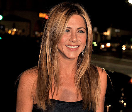 Being an American citizen , Aniston still has blood of what nationality running through her veins?