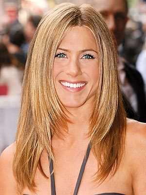 To what rock star was Aniston linked to romantically in the past?
