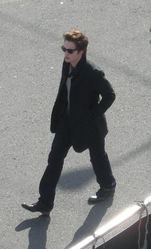 Can some1 plz explain me why Edward is wearing sunglasses in the Twilight movie at a point?