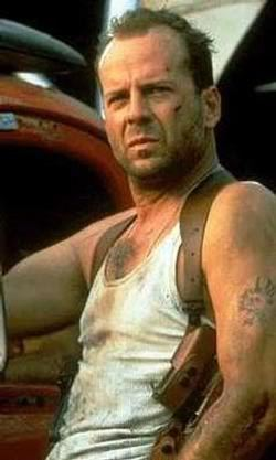Bruce Willis. Here is what he looked like younger in the first die hard movie. I also like Gerard Butler.