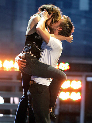 unfortuanetly no, it is not real. It is very well maniped picture of Ryan Gosling and Rachel McAdams' kiss when they accepted the mtv movie award for best kiss.