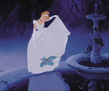 If you watch the film, there is a point when you see her reflection in some water, and the reflection of the dress seems fairly blue. Also when walking in the moonlight with the Prince her dress gives off a blueish colour.  Another reason may be to make each princess have a specific colour combination to differentiate each princess with each other- Snow White: The Primary Colours, Red, Blue, Yellow Cinderella: Blue (even though her dress was really white) Aurora: Pink (even though she spent most of the time in the film wearing the blue version) Ariel: Iconic Red, Green, Purple combination as Mermaid, plus her Baby Pink coloured dress. Belle: Yellow Jasmine: Turquoise