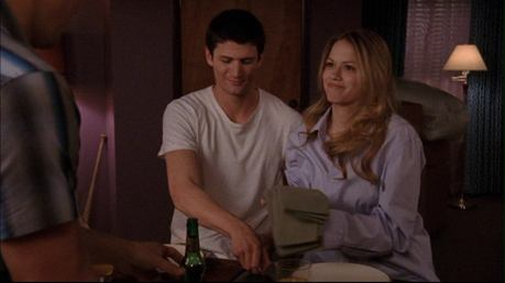 In 319 when Nathan and Haley are eating breakfast with Cooper; Haley accidentally bumps her elbow on