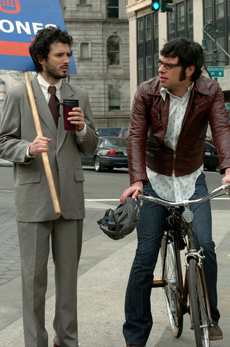 Flight of the Conchords karatasi la kupamba ukuta probably with a street, a bicycling, and a business suit entitled Flight of the Conchords