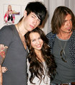 Miley Cyrus with her father and her brother