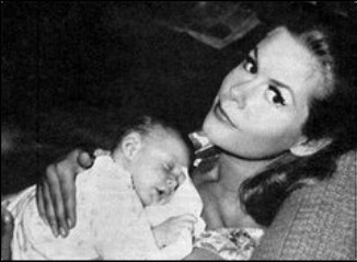 Elizabeth Montgomery wallpaper called Elizabeth With First Baby Son William Jr In 1964