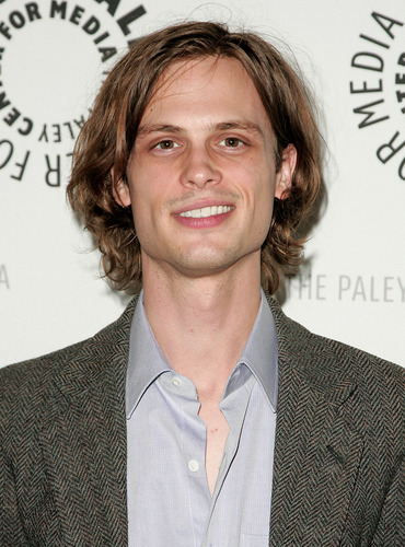 Criminal Minds Hintergrund with a business suit titled Matthew Gray Gubler