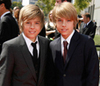 The Sprouse Brothers photo containing a business suit titled Dylan and Cole Sprouse