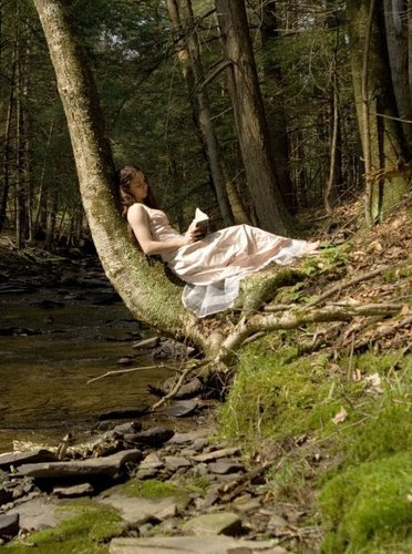 boeken to Read achtergrond titled Girl Reading in a Forest
