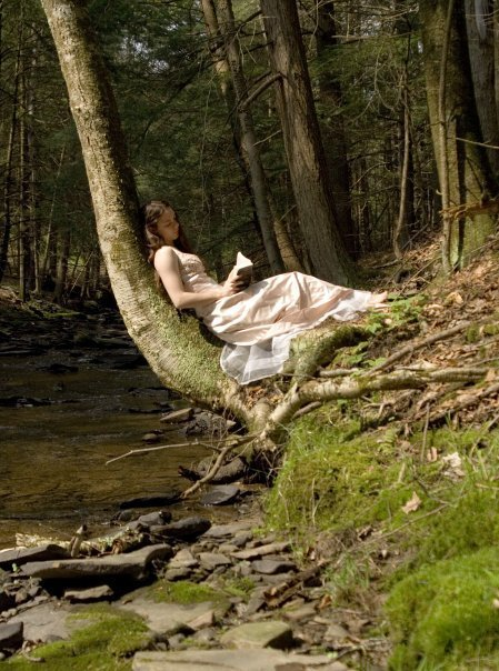 Girl Reading in a Forest