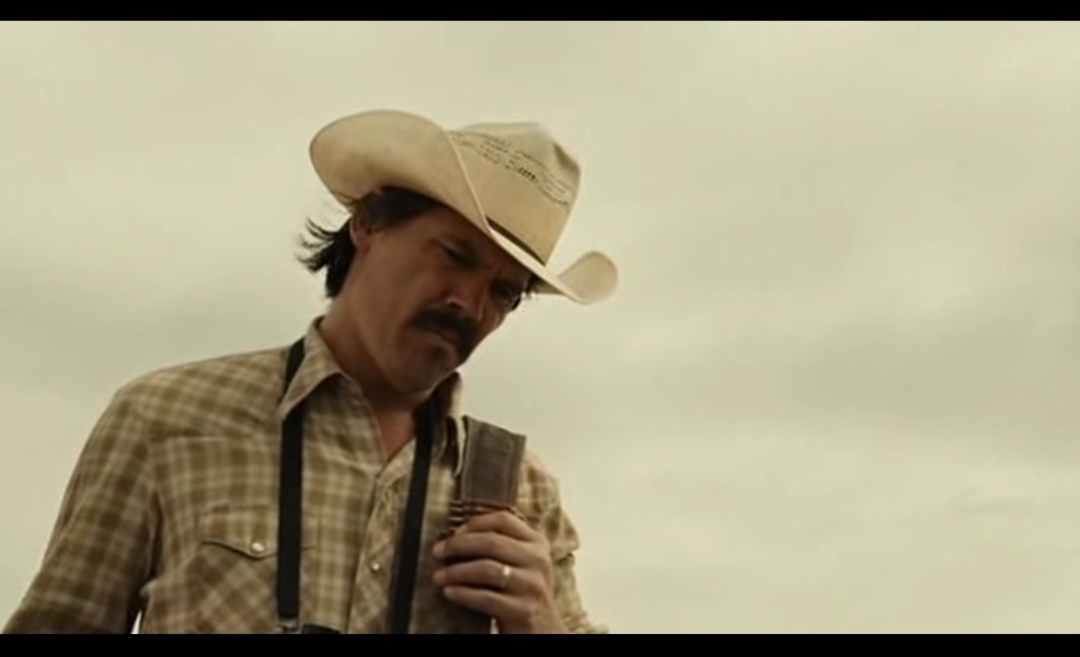 What is a thesis I can come up with for an essay on No Country for Old Men?