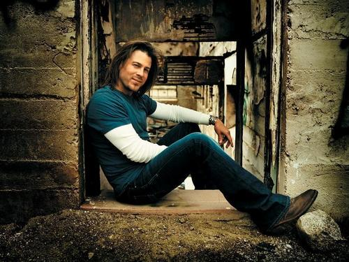 Christian Kane wallpaper probably with a hip boot, a street, and a sign called Christian Kane picture