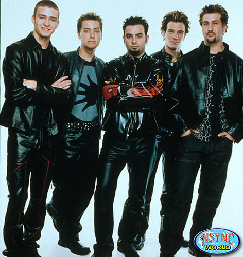 NSYNC achtergrond with a well dressed person, a business suit, and long trousers titled NSYNC