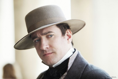 Little Dorrit wallpaper with a fedora, a business suit, and a snap brim hat entitled Production Still